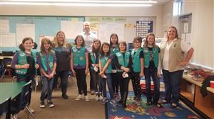 girl scouts present to district and school leadership